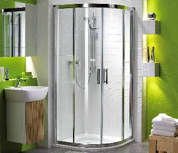 Kabina prysznicowa w zielonej łazience.