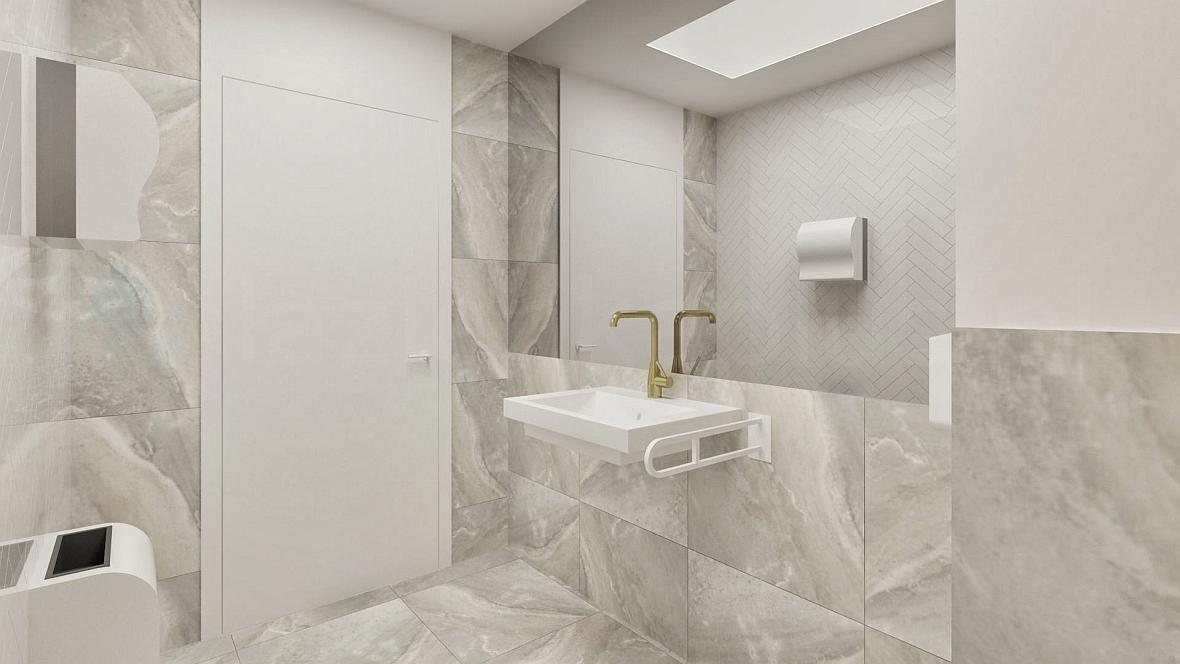 Łazienka ze złotą baterią umywalkową